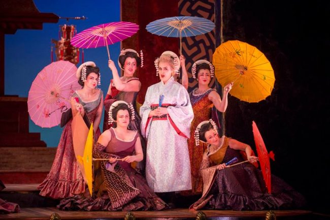 Sioned Gwen Davies as Pitti-Sing, and The Chorus of The Mikado